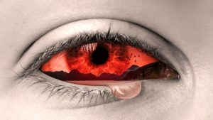 Tear falling from an eye coloured in red for pain.